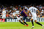 Luis Suarez of FC Barcelona (R) in action against Geoffrey Kondogbia of Valencia CF (L) during their La Liga 2018-19 match between Valencia CF and FC Barcelona at Estadio de Mestalla on October 07 2018 in Valencia, Spain. Photo by Maria Jose Segovia Carmona / Power Sport Images