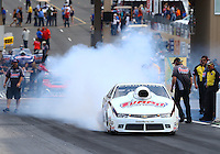 Jul. 18, 2014; Morrison, CO, USA; NHRA pro stock driver Greg Anderson during qualifying for the Mile High Nationals at Bandimere Speedway. Mandatory Credit: Mark J. Rebilas-