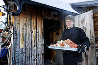 Arctic Circle, Norway, Kirkenes, Snow Hotel. Cooking King crab after ice fishing.