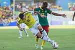 James Rodriguez of Colombia holds off pressure from  Ngwemi of Camerun during the friendly match between Camerun and Colombia in Madrid, Spain 13 jun 2017.(ALTERPHOTOS/Rodrigo Jimenez)