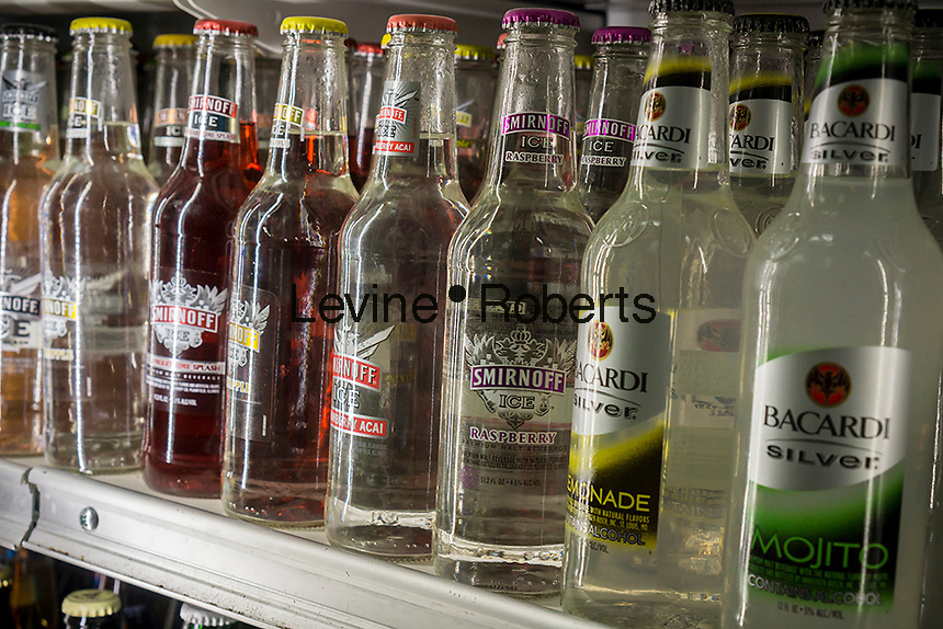 Bottles of Smirnoff and Bacardi brand flavored malt beverages are seen in a cooler in a bodega in the Bronx in New York on Thursday, September 19, 2013.  (© Richard B. Levine)