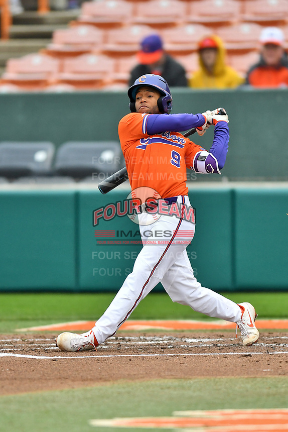 Clemson Tigers second baseman Jordan Greene (9) swings at a pitch during a game against the North Carolina Tar Heels at Doug Kingsmore Stadium on March 9, 2019 in Clemson, South Carolina. The Tigers defeated the Tar Heels 3-2 in game one of a double header. (Tony Farlow/Four Seam Images)