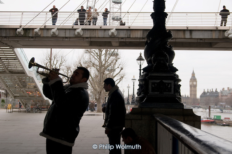 Trumpet-playing buskers on the South Bank, London.