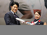 "April 21, 2018, Tokyo, Japan - Japanese actor Ryohei Suzuki (L) receives a model plane from a Japan Airlines (JAL) cabin attendant at a JAL hanger of Tokyo's Haneda airport on Saturday, April 21, 2018. JAL unveiled a wrapped jetliner with casts' faces of a TV drama ""Segodon"" .   (Photo by Yoshio Tsunoda/AFLO) LWX -ytd-"