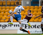 St Johnstone v Hearts...03.08.14  Steven Anderson Testimonial<br /> Danny Wilson tackles Liam Caddis<br /> Picture by Graeme Hart.<br /> Copyright Perthshire Picture Agency<br /> Tel: 01738 623350  Mobile: 07990 594431