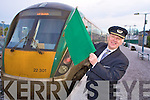 Killarney Station Master Michael Leahy, raises the flag for the last time as he retires after 39 years service.