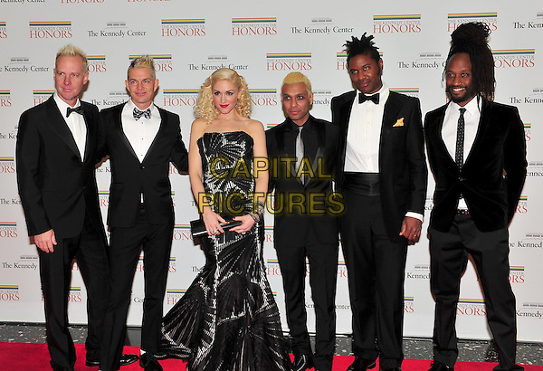 "Gwen Stefani and the group ""No Doubt"" .The formal Artist's Dinner at the United States Department of State in Washington, D.C., USA..December 4th, 2010.full length black strapless dress fishtail suit tuxedo pinstripe striped stripes.CAP/ADM/RS.©Ron Sachs/CNP/AdMedia/Capital Pictures."