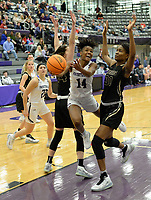 Fayetteville's Coriah Beck (14) reaches to score Friday, Jan. 17, 2020, over Bentonville's Maryam Dauda (right) and Bella Irlenborn during the first half of play in Bulldog Arena in Fayetteville. Visit nwaonline.com/prepbball/ for a gallery from the games.<br /> (NWA Democrat-Gazette/Andy Shupe)