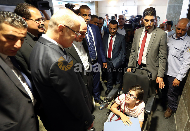 Palestinian Prime Minister Rami Hamdallah attends the graduation ceremony of the 37 at Al-Najah University in West bank city of Nablus on July 6,2017. Photo by Prime Minister Office