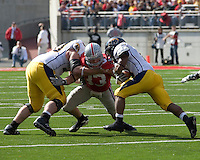 Ohio State linebacker James Laurinaitis (33) splits two defenders to make a tackle on Kent State running back Eugene Jarvis (6).  The Ohio State Buckeyes defeated the Kent State Golden Flashes 48-3 on  October 13, 2007 at Ohio Stadium, Columbus, Ohio.
