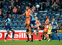 Neil Danns of Blackpool and Sam Saunders of Wycombe Wanderers during the Sky Bet League 2 match between Wycombe Wanderers and Blackpool at Adams Park, High Wycombe, England on the 11th March 2017. Photo by Liam McAvoy.