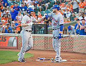 New York Mets second baseman Daniel Murphy (28) is congratulated by first baseman Lucas Duda (21) after connecting for a first inning home run against the Baltimore Orioles at Oriole Park at Camden Yards in Baltimore, Maryland on Wednesday, August 19, 2015.  The Orioles won the game 5 - 4.<br /> Credit: Ron Sachs / CNP<br /> (RESTRICTION: NO New York or New Jersey Newspapers or newspapers within a 75 mile radius of New York City)