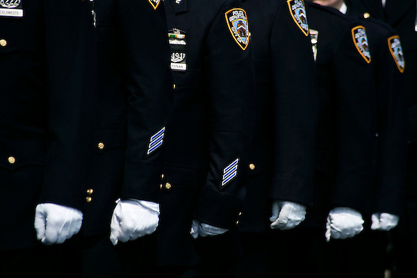 Thousands of police officers and military turned out for the funeral of James McNaughton, the first NYPD officer killed in the war in Iraq. Gloves of the honor guard of the NYPD.