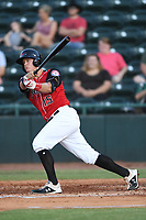 Josh Jung (15) of the Hickory Crawdads follows through on his swing during a game against the West Virginia Power at L.P. Frans Stadium on July 25, 2019 in Hickory, North Carolina. The Power defeated the Crawdads 3-2. (Tracy Proffitt/Four Seam Images)
