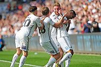 Kyle Naughton (right) of Swansea City celebrates scoring his side's third goal with team mates during the Sky Bet Championship match between Swansea City and Rotherham United at the Liberty Stadium in Swansea, Wales, UK.  Friday 19 April 2019