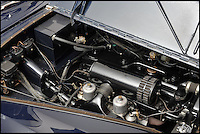 BNPS.co.uk (01202 558833)<br /> Pic: Bonhams/BNPS<br /> <br /> 4.6 litre 6 cylinder engine was smooth enough to avoid the champagne being spilt.<br /> <br /> Downfall - The car that led to the chairman of Daimler's dramatic fall after the extravagent behaviour of his notorious socialite wife.<br /> <br /> This luxurious limousine designed by legendary aristocrat Lady Docker as a vanity project, and which eventually cost her and her husband their jobs, is tipped to sell for &pound;160,000 at Bonhams.<br /> <br /> The unique 'Stardust' Daimler was one of five show cars styled by exuberant socialite Lady Docker and cost so much they almost bankrupt the company behind them.<br /> <br /> The 1954 dark blue Daimler was so lavish it has 5,000 hand painted silver stars on the exterior, an interior full of crocodile skin and hand woven silk, and even a dancer mascot on the bonnet modelled on ex-showgirl Norah Docker herself.<br /> <br /> The flamboyant vehicle is even being sold with an invitation to Princess Grace's Monaco wedding in 1956, to which the Dockers shipped two of the luxury cars for their own personal use, and was the final straw for frustrated Daimler board members back home in austerity hit Britain.