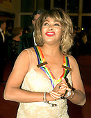 2005 Kennedy Center honoree Tina Turner arrives for the 2005 Kennedy Center Honors taping at the John F. Kennedy Center for the Performing Arts in Washington, D.C. on Sunday, December 4, 2005. The 2005 honorees are Tony Bennett, Suzanne Farrell, Julie Harris, Robert Redford, and Tina Turner..Credit: Ron Sachs / CNP