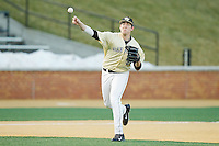 Wake Forest Demon Deacons third baseman Will Craig (22) makes a throw to first base against the Cincinnati Bearcats at Wake Forest Baseball Park on February 21, 2014 in Winston-Salem, North Carolina.  The Bearcats defeated the Demon Deacons 5-0.  (Brian Westerholt/Four Seam Images)