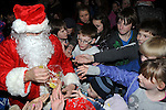 Santa gives out lollypops at the Clogherhead Christmas fair. Photo: Colin Bell/pressphotos.ie