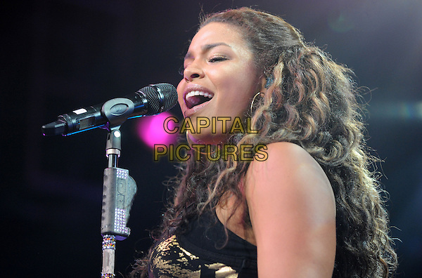 JORDIN SPARKS .performs live during The Battlefield Tour held at The Grove of Anaheim in Anaheim, California, USA, .July 2nd 2010..portrait headshot music on stage in concert gig black gold print vest top microphone singing .CAP/RKE/DVS.©DVS/RockinExposures/Capital Pictures.