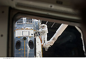 In Earth Orbit - May 14, 2009 -- Perched on the end of the Canadian-built remote manipulator system, astronaut Andrew Feustel, mission specialist, performs work on the Hubble Space Telescope as the first of five STS-125 spacewalks kicks off a week's work on the orbiting observatory. Feustel, teamed with astronaut John Grunsfeld (out of frame), will join the veteran spacewalker on two of the remaining four sessions of extravehicular activity later in the mission..Credit: NASA via CNP