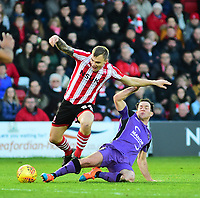 Lincoln City's Harry Anderson is fouled by  Port Vale's Luke Joyce<br /> <br /> Photographer Andrew Vaughan/CameraSport<br /> <br /> The EFL Sky Bet League Two - Lincoln City v Port Vale - Tuesday 1st January 2019 - Sincil Bank - Lincoln<br /> <br /> World Copyright &copy; 2019 CameraSport. All rights reserved. 43 Linden Ave. Countesthorpe. Leicester. England. LE8 5PG - Tel: +44 (0) 116 277 4147 - admin@camerasport.com - www.camerasport.com