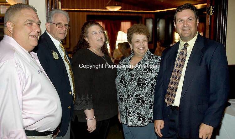 WATERBURY CT. 24 July 2014-072414SV03-From left, Walter Sherman of Wolcott, Alan Daninhirsch of Bristol, New Britain Lions Club, Lisa Martin, president of Waterbury Lions Club, Judy Aronin of Norwalk, aunt, and Dr. Steven Aronin of Waterbury at the Waterbury Lions Club meeting in Waterbury Thursday. Dr. Steven Aronin was being inducted into the Waterbury Lions Club. . <br /> Steven Valenti Republican-American