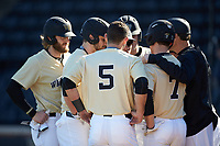 The Wake Forest Demon Deacons huddle up during the game against the Gardner-Webb Runnin' Bulldogs at David F. Couch Ballpark on February 18, 2018 in  Winston-Salem, North Carolina. The Demon Deacons defeated the Runnin' Bulldogs 8-4 in game one of a double-header.  (Brian Westerholt/Four Seam Images)