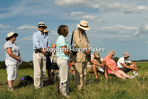 Pilgrims pray as the Bishop of Norwich , the Rev Graham James conducts an interdenominational service at the ruined abbey of St Benets. Ludham, Norfolk UK. Annually first Sunday in August.
