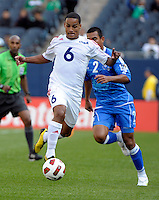 Cuba's Joel Colomé dribbles in front of El Salvador's Xavier Garcia.  El Salvador defeated Cuba 6-1 at the 2011 CONCACAF Gold Cup at Soldier Field in Chicago, IL on June 12, 2011.
