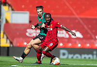 5th July 2020, Anfield, Liverpool, England;  Liverpools Naby Keita  turns away from Aston Villas Jack Grealish during the Premier League match between Liverpool and Aston Villa at Anfield in Liverpool