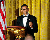 United States President Barack Obama makes remarks as he and first lady Michelle Obama host a dinner to honor our Armed Forces who served in Operation Iraqi Freedom and Operation New Dawn and to honor their families in the East Room of the White House in Washington, D.C. on Wednesday, February 29, 2012..Credit: Ron Sachs / Pool via CNP