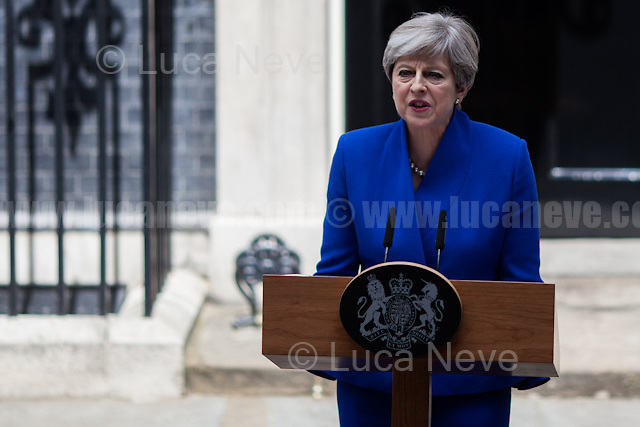 London, 09/06/2017. Today, the newly elected British Prime Minister, Theresa May, speaks outside 10 Downing Street to announce the result of the General Election 2017, where the Conservative Party lost its parliamentary majority and the election resulted in a hung Parliament, and to inform the public that she will form her new minority Conservative government in coalition with the Democratic Unionist Party (DUP - http://bit.ly/2s93eHf), the largest unionist political party in Northern Ireland led by Arlene Foster. Earlier, Theresa May and her husband, Philip John May, went to Buckingham Palace to meet HM Queen Elizabeth II seeking the permission to form May's second Government as British Prime Minister.<br /> After 5 years of the Coalition Government (Conservatives &amp; Liberal Democrats) led by the Conservative Party leader David Cameron, and one year of David Cameron's Government (Who resigned after the Brexit victory at the EU Referendum held in 2016), British people voted in the following way: Conservative Party 318 seats (42.4% - 13,667,213 votes &ndash; 12 seats less than 2015), Labour Party 262 seats (40,0% - 12,874,985 votes &ndash; 30 seats more then 2015); Scottish National Party, SNP 35 seats (3,0% - 977,569 votes &ndash; 21 seats less than 2015); Liberal Democrats 12 seats (7,4% - 2,371,772 votes &ndash; 4 seats more than 2015); Democratic Unionist Party 10 seats (0,9% - 292,316 votes &ndash; 2 seats more than 2015); Sinn Fein 7 seats (0,8% - 238,915 votes &ndash; 3 seats more than 2015); Plaid Cymru 4 seats (0,5% - 164,466 votes &ndash; 1 seat more than 2015); Green Party 1 seat (1,6% - 525,371votes &ndash; Same seat of 2015); UKIP 0 seat (1.8% - 593,852 votes); others 1 seat. <br /> The definitive turn out of the election was 68.7%, 2% higher than the 2015.<br /> <br /> For more information click here: http://bbc.in/2qVyNRd &amp; http://bit.ly/2s9ob51<br /> <br /> For my reportage about the &quot;Loyal Orange Lodge Annual Parade&quot; click here: http