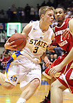 BROOKINGS, SD - JANUARY 12: Nate Wolters of South Dakota State drives into University of South Dakota defenders during their game Thursday evening at Frost Arena.  (Photo by Dave Eggen/Inertia)