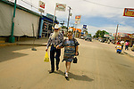 ALGODONES, MEXICO-MARCH 23: A retired couple stroll down Avenue A looking for bargains March 23, 2005 in Algdones. Algdones is a popular destination for day trips for Americans seeking to save money on prescription drugs and medical services. Local officials estimate that American tourists spend on average 100 USD per day per person here. ©Radhika Chalasani