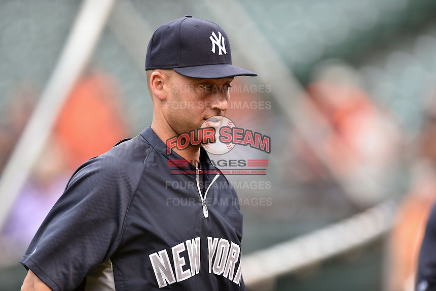 New York Yankees shortstop Derek Jeter #2 warms up before a game against the Baltimore Orioles at Oriole Park at Camden Yards August 11, 2014 in Baltimore, Maryland. The Orioles defeated the Yankees 11-3. (Tony Farlow/Four Seam Images)