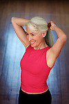 Beautiful white haired woman tying back her hair