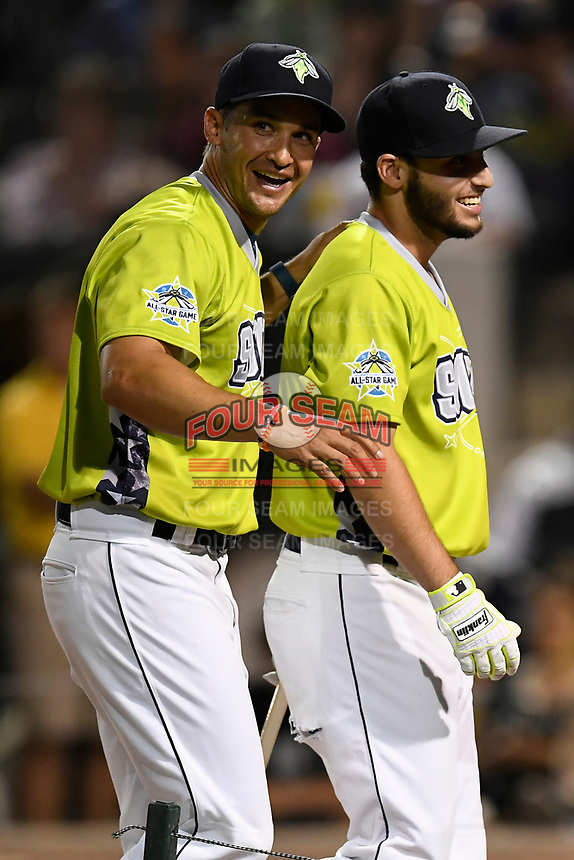 Manager Jose Leger congratulates Michael Paez of the Columbia Fireflies in the Home Run Derby as part of of the South Atlantic League All-Star Game festivities on Monday, June 19, 2017, at Spirit Communications Park in Columbia, South Carolina. (Tom Priddy/Four Seam Images)