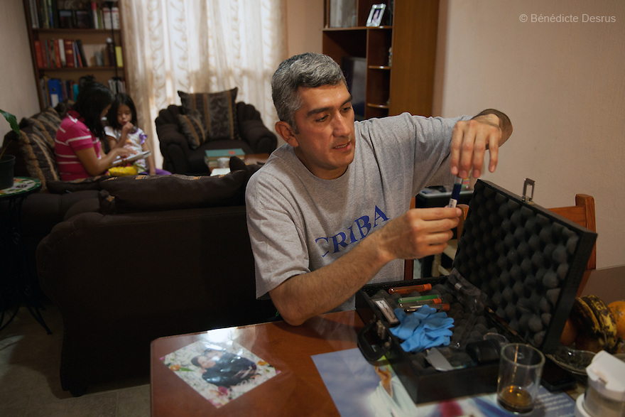 """Donovan chooses chemical formulas for his forensic cleaning kit at his home in Texcoco, Mexico on May 21, 2015. Donovan prefers not to write down or otherwise record the 370 formulas he has memorized for his work, so they cannot be stolen. Donovan Tavera, 43, is the director of """"Limpieza Forense México"""", the country's first and so far the only government-accredited forensic cleaning company. Since 2000, Tavera, a self-taught forensic technician, and his family have offered services to clean up homicides, unattended death, suicides, the homes of compulsive hoarders and houses destroyed by fire or flooding. Despite rising violence that has left 70,000 people dead and 23,000 disappeared since 2006, Mexico has only one certified forensic cleaner. As a consequence, the biological hazards associated with crime scenes are going unchecked all around the country. Photo by Bénédicte Desrus"""