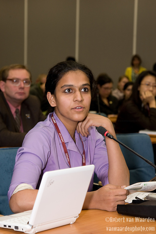 An Indian Youth Delegate listens to the  Intergenerational Inquiry on Climate Solutions. Poznan..UNFCCC COP 14 (©Robert vanWaarden ALL RIGHTS RESERVED)