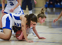 NWA Democrat-Gazette/CHARLIE KAIJO Bentonville West High School guard Samantha White (2) and Rogers High School forward Amber Covington (22) reaches for a loose ball during a basketball game, Friday, February 8, 2019 at Rogers High School in Rogers.