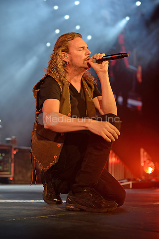 MIAMI FL - JULY 02: Fher Olvera of Mana performs at The AmericanAirlines Arena on July 2, 2015 in Miami, Florida. Credit: mpi04/MediaPunch