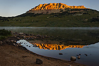 Beartooth Butte reflecting in Beartooth Lake shortly after sunrise.  Wyoming.  Summer.