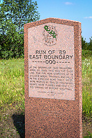 "Land Run of 1889 Boudary  Marker on Route 66, near Luther Oklahoma.  ""At the opeing of old Oklahoma April 22, 1889. This was the East line for the run starting at 12 o'clock noon. Prairies and hills in the 2,000,000 acre track west were peopled by tens of thousands. Homes were planted and tent cities sprang up before nightfall."""
