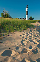 Footsteps mark the shoreline sand at Big Sable Lighthouse in Michigan's Ludington State Park