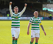 17th March 2019, Dens Park, Dundee, Scotland; Ladbrokes Premiership football, Dundee versus Celtic; Mikael Lustig of Celtic and Scott Brown of Celtic celebrate the win