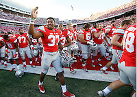 Ohio State Buckeyes linebacker Joshua Perry (37) acknowledges fans as he leaves the field following Ohio State's 38-0 win over Hawaii in the NCAA football game at Ohio Stadium in Columbus on Sept. 12, 2015. (Adam Cairns / The Columbus Dispatch)