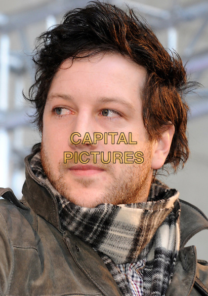 Matt Cardle.BBC Children In Need's Pudsey Street -photocall, New Piazza, Covent Garden, London, England..3rd November 2012.on stage in concert live gig performance performing music headshot portrait  grey gray   jacket white scarf plaid tartan stubble facial hair   .CAP/PP/BK.©Bob Kent/PP/Capital Pictures