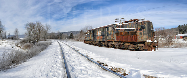 GG1 electric railroad locomotive sitting abandoned and isolated in winter snow, former PRR #4917, Penn Central #4934.