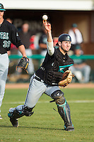 Coastal Carolina Chanticleers catcher John McNulty (30) makes a throw to first base against the High Point Panthers at Willard Stadium on March 15, 2014 in High Point, North Carolina.  The Chanticleers defeated the Panthers 1-0 in the first game of a double-header.  (Brian Westerholt/Four Seam Images)
